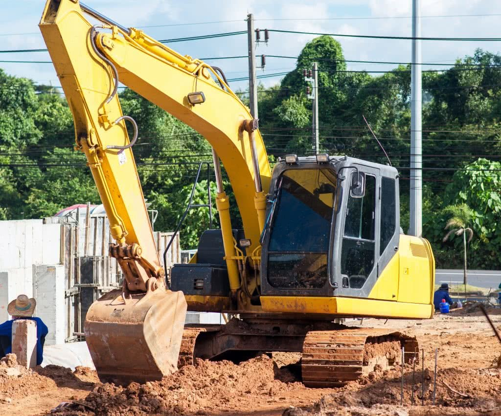 A bulldozer excavating an area in preparation for building a new home