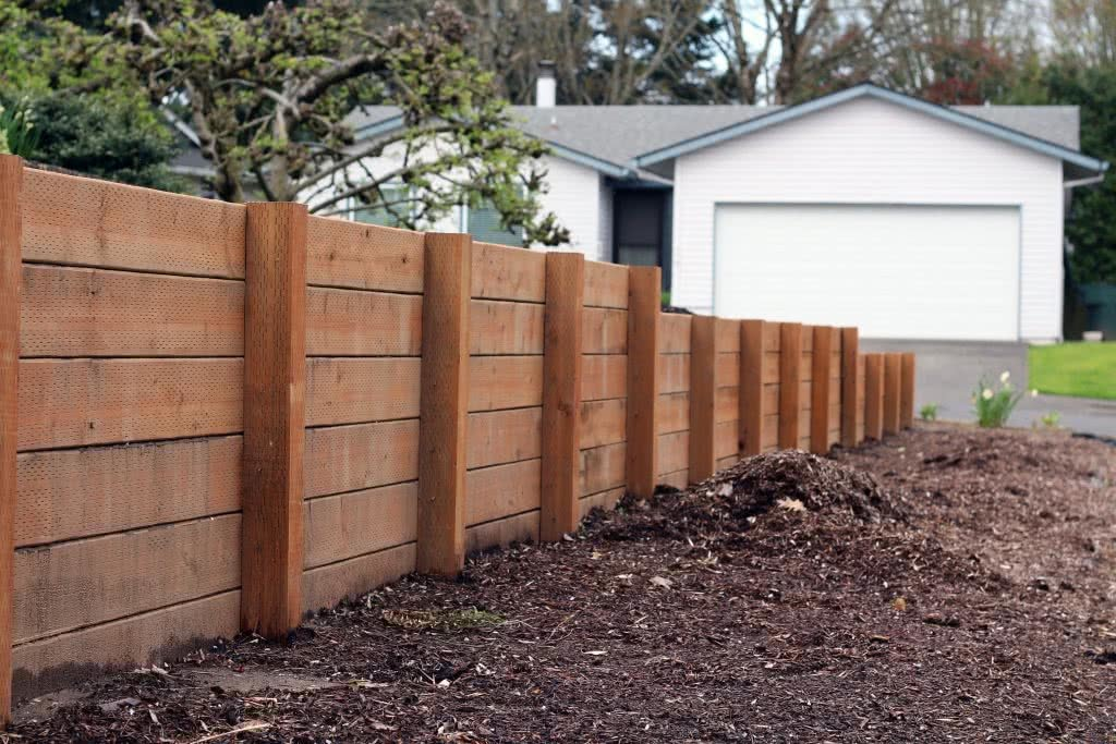 Retaining wall running through a yard which is a consideration for new home building