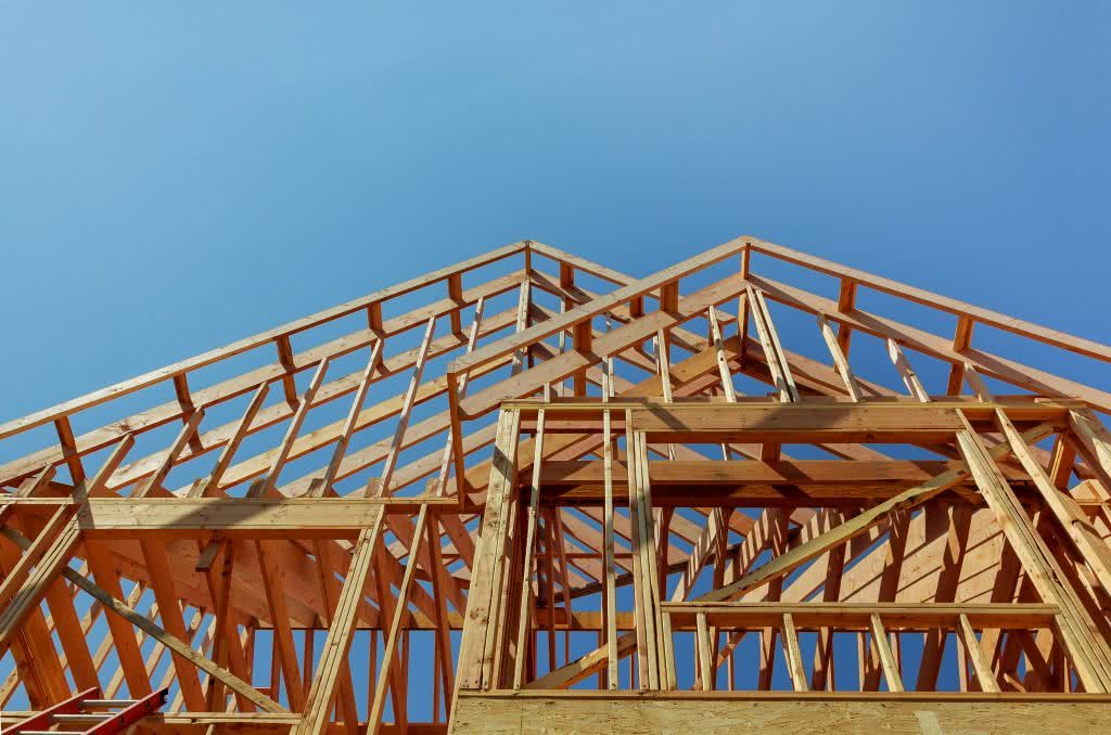 Timber frames and trusses during building of a new home